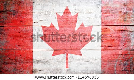 Flag of Canada painted on grungy wood plank background - stock photo