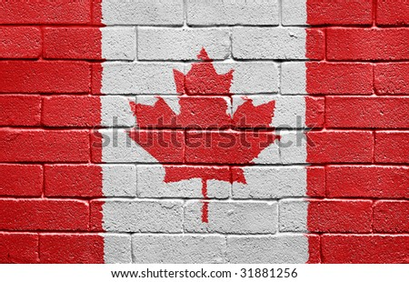 Flag of Canada painted onto a grunge brick wall - stock photo