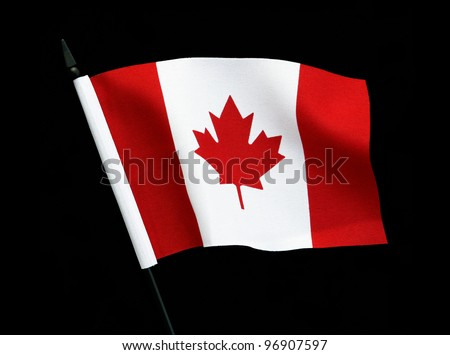 Flag of Canada with flag pole over black background - stock photo
