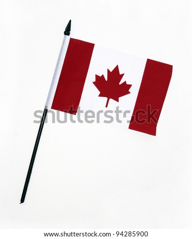 Flag of Canada with flag pole over white background - stock photo