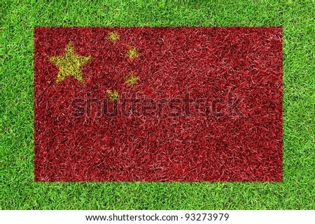 Flag of China as a painting on green grass background - stock photo