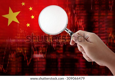 Flag of China. Downtrend stock data diagram with hand holding magnifying glass analyze solution ideas concept design - stock photo