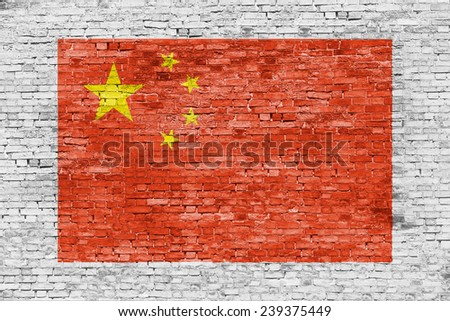 Flag of China painted over white brick wall