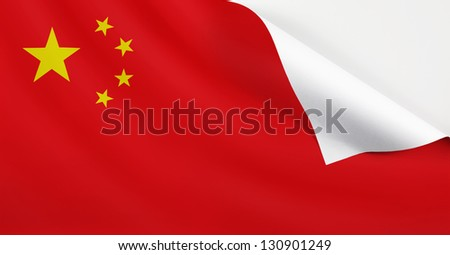 Flag of China with a curl at the corner with blank space for text. - stock photo