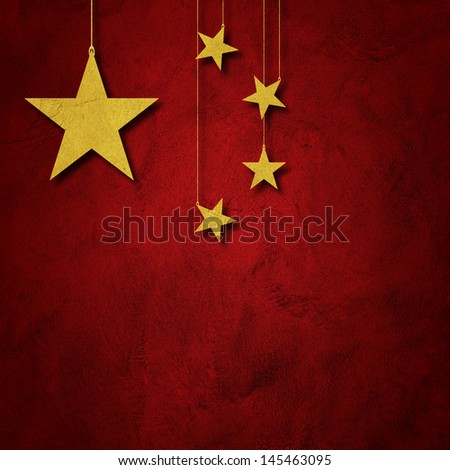 Flag of China. Yellow stars paper cutout hang from roof on red grunge wall - stock photo