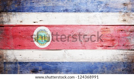 Flag of Costa Rica painted on grungy wood plank background - stock photo