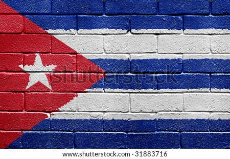 Flag of Cuba painted onto a grunge brick wall - stock photo