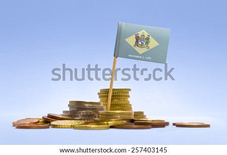 Flag of Delaware in a mixed stack of european coins and a blue background.(series) - stock photo