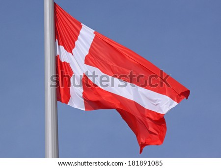 flag of Denmark over blue sky - stock photo
