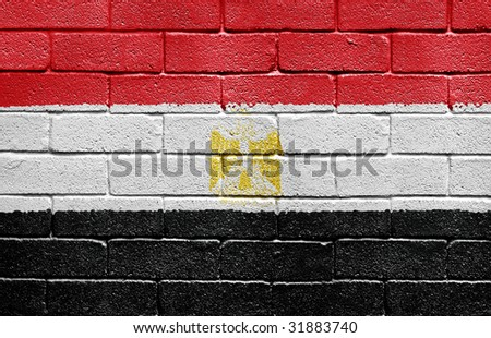 Flag of Egypt painted onto a grunge brick wall - stock photo