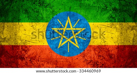 flag of Ethiopia or Ethiopian banner on rough pattern metal background