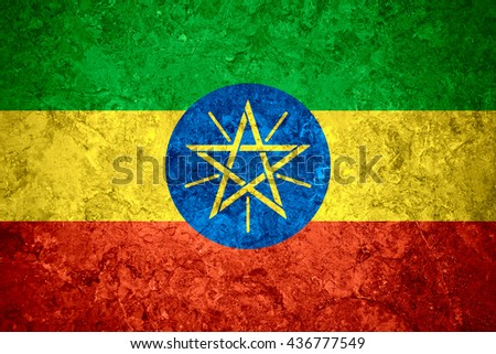 flag of Ethiopia or Ethiopian banner on vintage background
