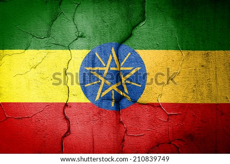 flag of Ethiopia painted on cracked wall - stock photo