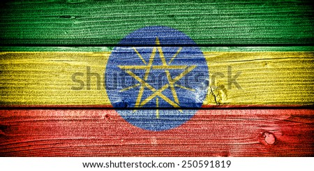 flag of Ethiopia painted on old grungy wooden  background - stock photo