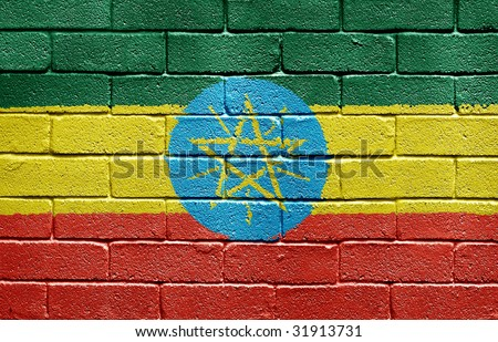 Flag of Ethiopia painted onto a grunge brick wall - stock photo