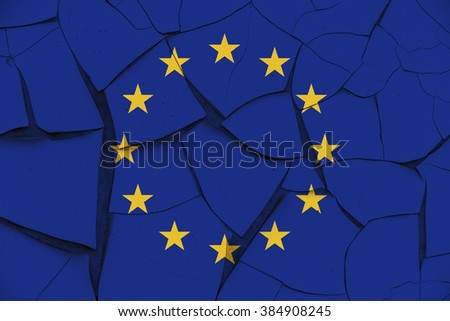 Flag of EU on a cracked paint wall. Consists of a circle of 12 golden (yellow) stars on an azure background. It is the flag and emblem of both the Council of Europe (CoE) and the European Union (EU). - stock photo