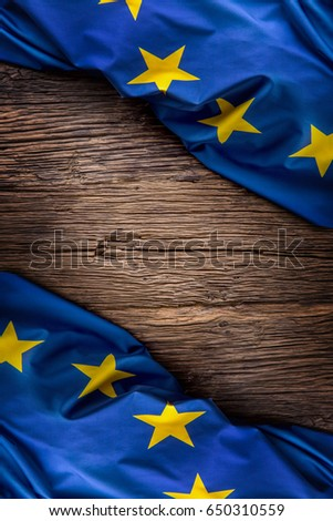 Flag of Europe union on old wooden background. EU flag old oak background.Vertical.