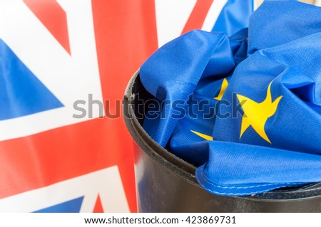 Flag of European Union in Dustbin with the Flag of the UK in background - stock photo