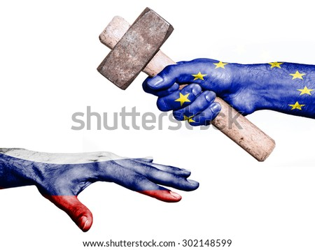 Flag of European Union overprinted on a hand holding a heavy hammer hitting a hand representing the Russia. Conceptual image for political, fiscal or social aggressions, penalties, taxation - stock photo