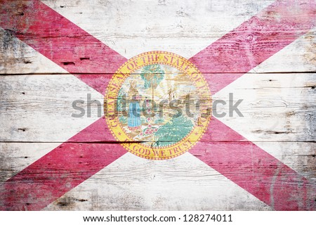Flag of Florida painted on grungy wooden background - stock photo