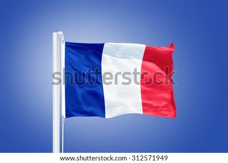 Flag of France flying against a blue sky. - stock photo
