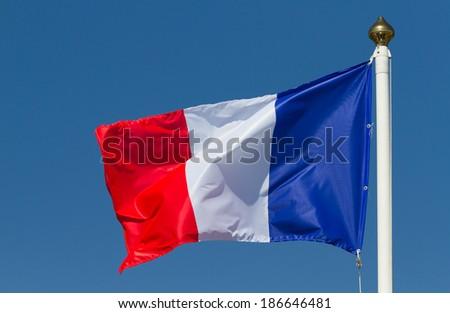 Flag of France on the blue  sky - stock photo