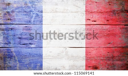 Flag of France painted on grungy wood plank background - stock photo
