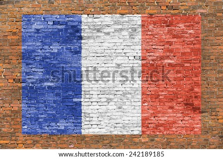Flag of France painted over aged brick wall - stock photo