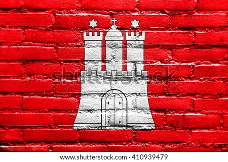 Flag of Free and Hanseatic City of Hamburg, painted on brick wall - stock photo