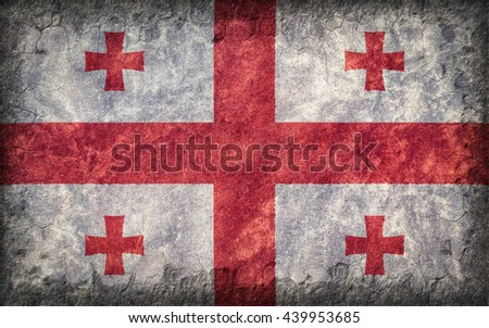 Flag of Georgia painted onto a rough wall - stock photo