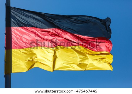 Flag of Germany on the blue sky background