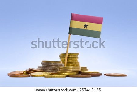 Flag of Ghana in a mixed stack of european coins and a blue background.(series) - stock photo