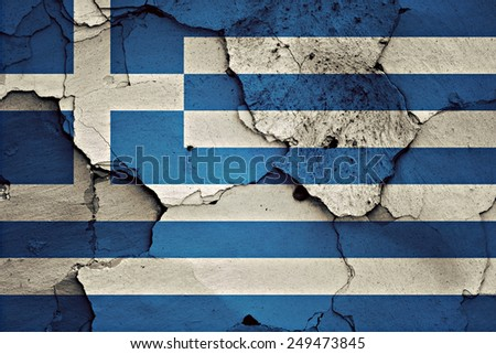 flag of Greece painted on cracked wall - stock photo
