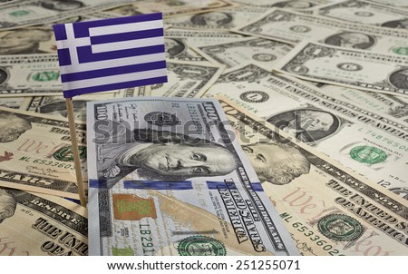 Flag of Greece sticking in a variety of american banknotes.(series) - stock photo