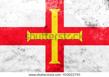 Flag of Guernsey, with a vintage and old look - stock photo