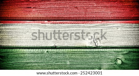 flag of Hungary painted on old grungy wooden  background - stock photo