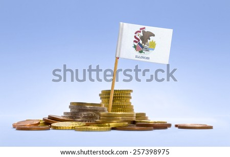 Flag of Illinois in a mixed stack of european coins and a blue background.(series) - stock photo