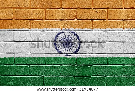 Flag of India painted onto a grunge brick wall - stock photo