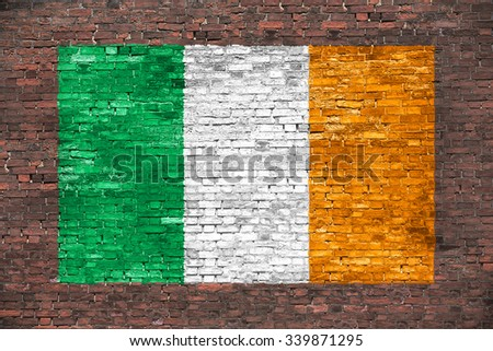 Flag of Ireland painted over old brick wall