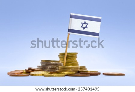 Flag of Israel in a mixed stack of european coins and a blue background.(series) - stock photo