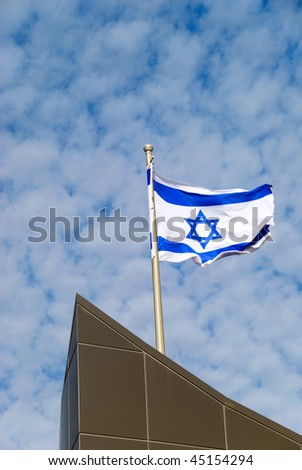 flag of Israel over cloudy sky