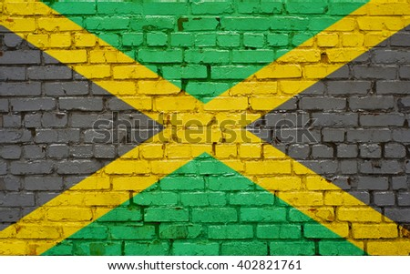 Flag of Jamaica painted on brick wall, background texture - stock photo