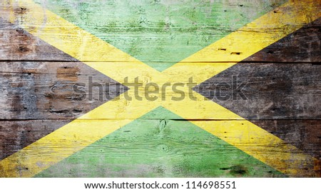 Flag of Jamaica painted on grungy wood plank background - stock photo
