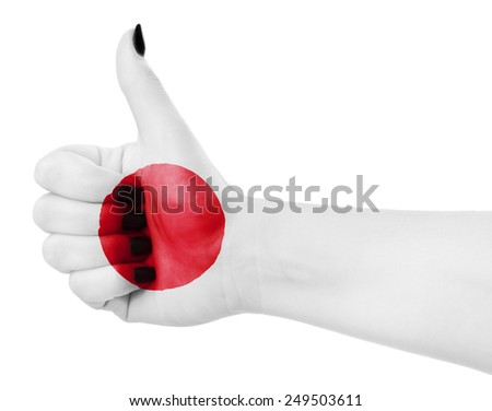 Flag of Japan on female's hand - stock photo