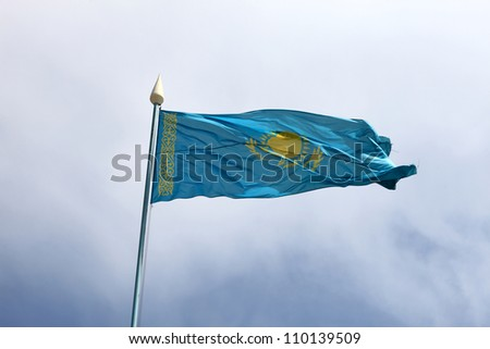 Flag of Kazakhstan on the blue sky background - stock photo