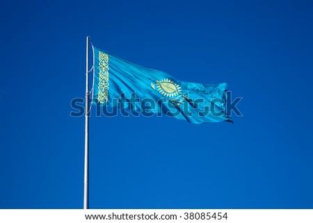 Flag of Kazakhstan Republic over blue sky. - stock photo