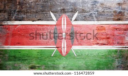 Flag of Kenya painted on grungy wood plank background - stock photo