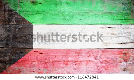 Flag of Kuwait painted on grungy wood plank background - stock photo