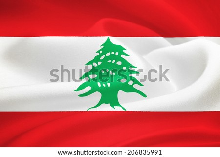 flag of Lebanon waving in the wind. Silk texture pattern - stock photo