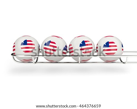 Flag of liberia on lottery balls. 3D illustration
